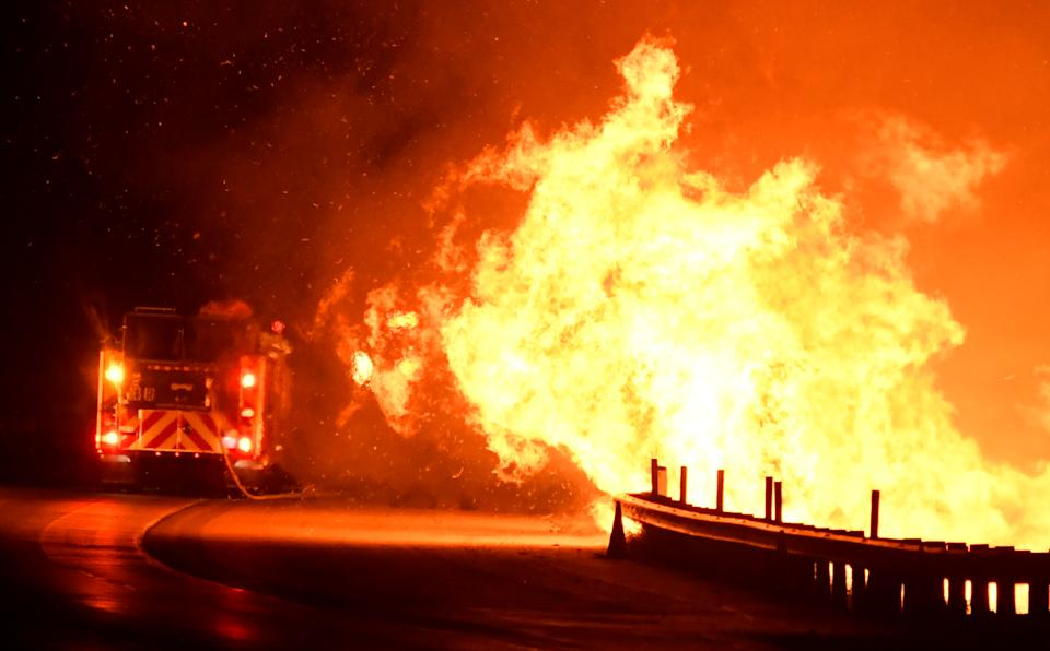 Firefighters battle a fire, as a wind driven wildfire continues to burn in Canyon Country north of Los Angeles, California, Oct. 25, 2019. (Photo: Gene Blevins/Reuters)
