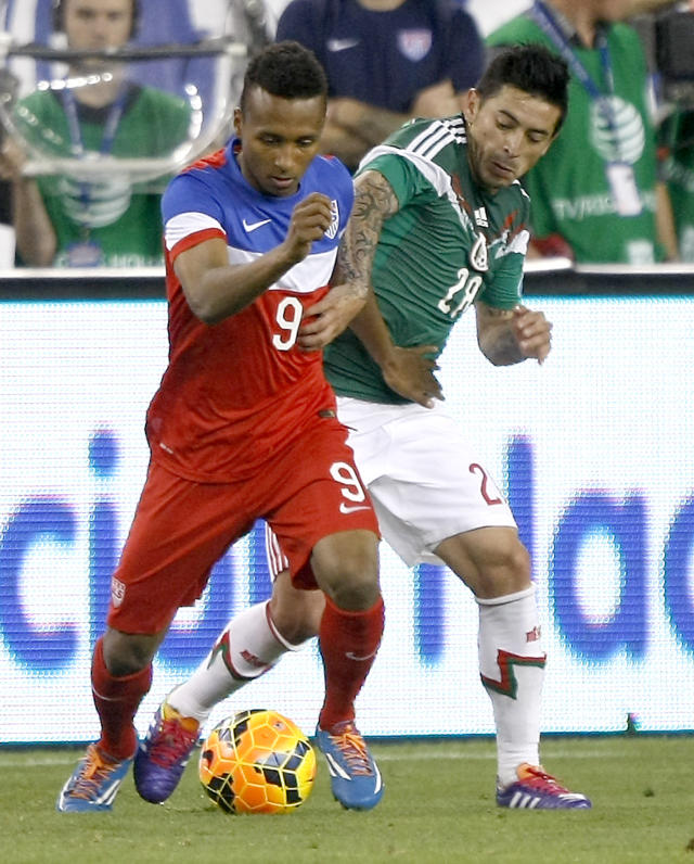 U.S. forward Julian Green (9) shields Mexico defenseman Rogelio Alfredo Chavex (28) from the ball during the second half of an international friendly soccer match Wednesday, April 2, 2014, in Glendale, Ariz. The game ended in a 2-2 draw. (AP Photo/Rock Scuteri)