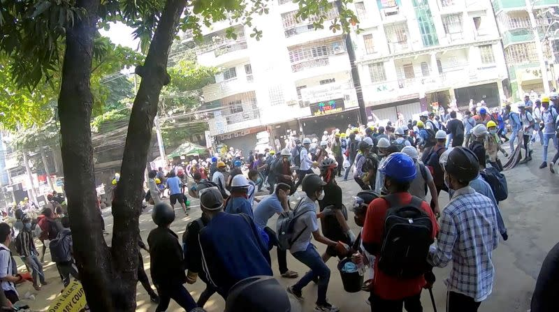 A-point-of-view from a volunteer medic running away with demonstrators from bullets, in Yangon