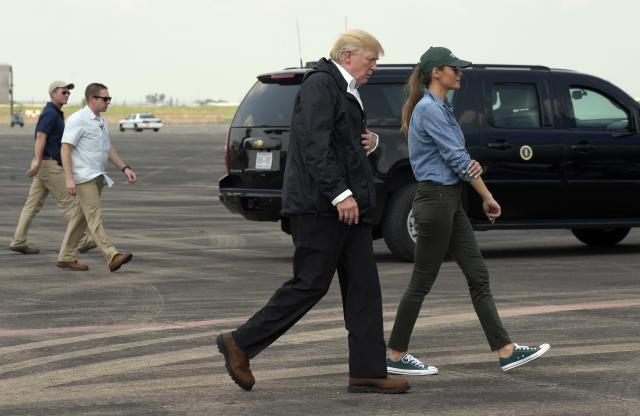 <p>President Donald Trump and Melania Trump walks to Air Force One at Ellington Field after meeting people impacted by Hurricane Harvey during a visit to Houston, Saturday, Sept. 2, 2017. (Photo: Susan Walsh/AP) </p>