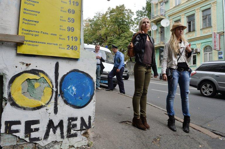 Activists from Ukrainian feminist movement FEMEN, Oleksandra Shevchenko (left) and Yana Zhdanova, outside the organisation's office in Kiev after police conducted a search on August 27, 2013. Ukrainian feminist movement Femen said Wednesday it was moving out of its Kiev offices, alleging official wiretapping, a day after police said they discovered a cache of illegal weapons in a raid