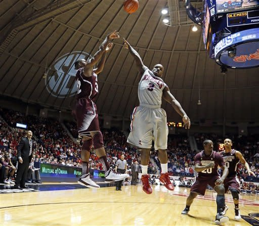 Mississippi State guard Craig Sword (32) shoots over Mississippi guard Derrick Millinghaus (3) in the second half of an NCAA college basketball game in Oxford, Miss., Wednesday, Feb. 6, 2013. Mississippi won 93-75. (AP Photo/Rogelio V. Solis)