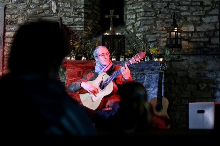 Belgian guitarist Quentin Dujardin performs in front of an audience of 15 at chapel Notre-Dame de Saint-Fontaine in Clavier, Belgium
