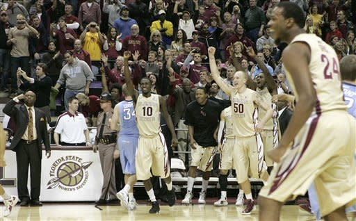Florida State players celebrate their 90-57 win No. 3 North Carolina in an NCAA college basketball game, Saturday, Jan. 14, 2012 in Tallahassee, Fla.(AP Photo/Steve Cannon)