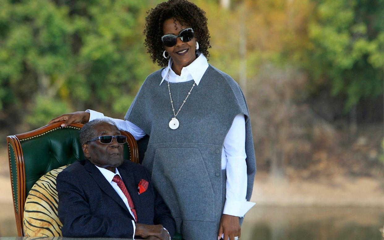 Robert Mugabe and his wife Grace, pictured in 2018 - AP