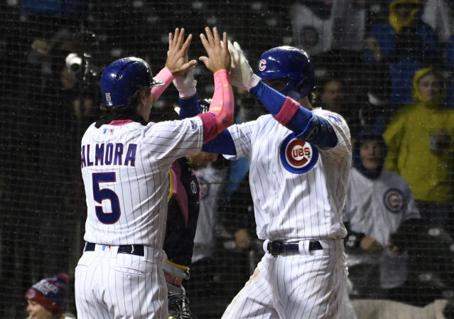 Chicago Cubs' Kris Bryant, right, is greeted by Albert Almora Jr.(5) after hitting a two-run home run against the Milwaukee Brewers during the seventh inning of a baseball game, Sunday, May, 12, 2019, in Chicago. (AP Photo/David Banks)