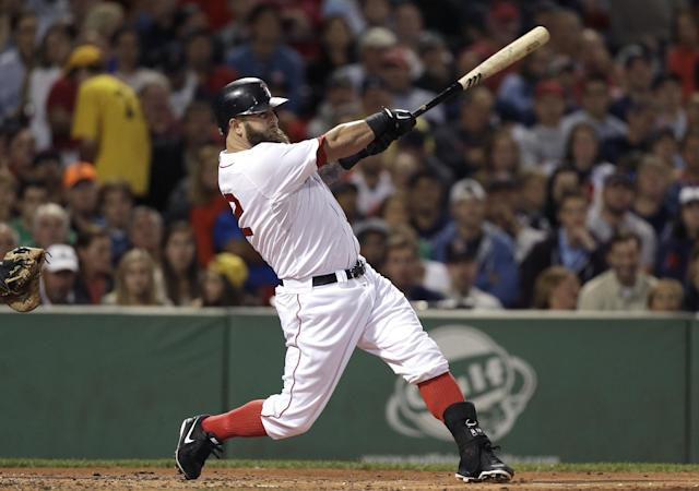 Boston Red Sox's Mike Napoli hits a two-run home run off a pitch by New York Yankees' Ivan Nova in the first inning of a baseball game at Fenway Park, in Boston, Sunday, Sept. 15, 2013. (AP Photo/Steven Senne)