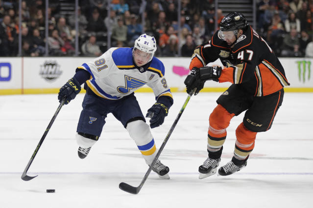 St. Louis Blues' Vladimir Tarasenko, left, of Russia, moves the puck past Anaheim Ducks' Hampus Lindholm, of Sweden, during the first period of an NHL hockey game Wednesday, March 6, 2019, in Anaheim, Calif. (AP Photo/Jae C. Hong)