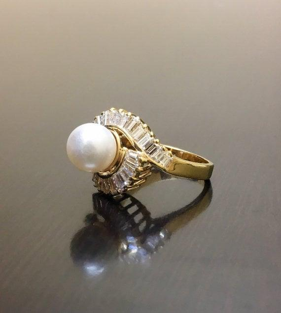 <p>This handmade <span>Art Deco Pearl Diamond Engagement Ring</span> ($3,500) features a set of baguette diamonds that will dazzle any bride.</p>