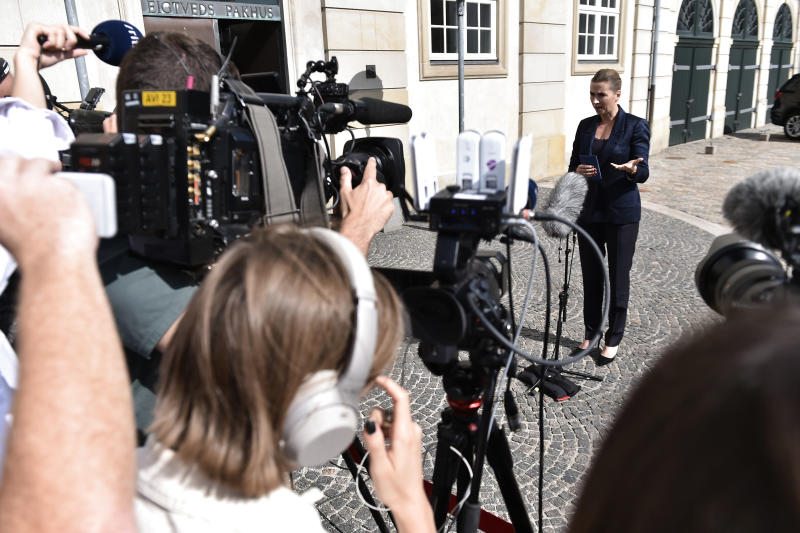 """Denmark's Prime Minister Mette Frederiksen gives a media comment about US President's cancellation of his scheduled State Visit, in front of the State Department in Copenhagen, Wednesday, Aug. 21, 2019.  U.S. President Trump announced his decision to postpone a visit to Denmark by tweet on Tuesday Aug. 20, 2019, after Danish Prime Minister Mette Frederiksen dismissed the notion of selling Greenland to the U.S. as """"an absurd discussion.""""  (Mads Claus Rasmussen / Ritzau Scanpix)"""