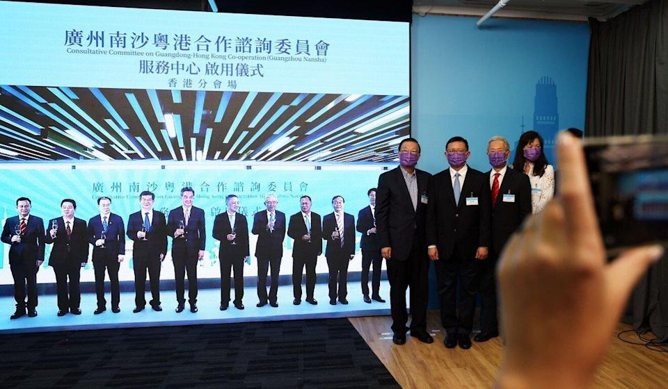 Former chief executive Leung Chun-ying and other dignitaries (on-screen) toast the launch of the new commercial services centre. Photo: Nora Tam