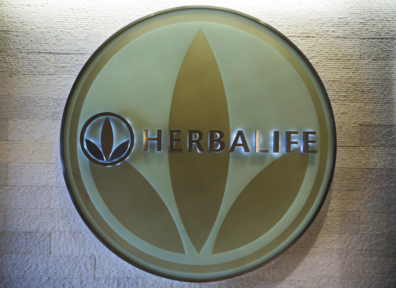 FILE- This May 11, 2016, file photo, shows the Herbalife logo at the company's corporate office, in Los Angeles. Some distributors who claim they were duped by Herbalife's promises they'd get rich selling health and personal care products are suing the company for as much as $1 billion in damages. (AP Photo/Damian Dovarganes, File)