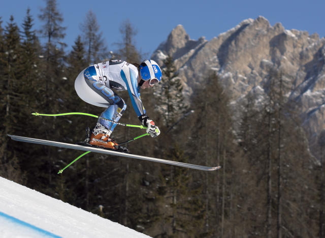 Stacey Cook of the United States speeds down the course during an alpine ski, women's World Cup downhill, in Cortina D'Ampezzo, Italy, Saturday, Jan. 25, 2014. Cook shared the 5th place with Austria's Anna Fenninger. (AP Photo/Domenico Stinellis)