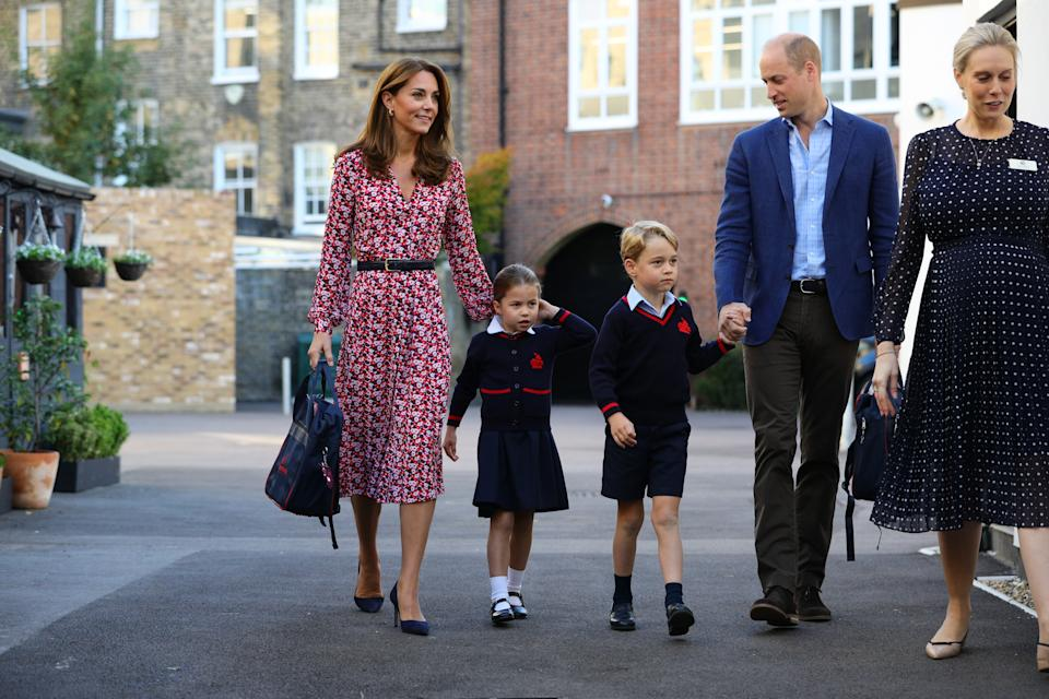 LONDON, UNITED KINGDOM - SEPTEMBER 5: Helen Haslem (right), head of the lower school greets Princess Charlotte as she arrives for her first day of school, with her brother Prince George and her parents the Duke and Duchess of Cambridge, at Thomas's Battersea in London on September 5, 2019 in London, England. (Photo by Aaron Chown - WPA Pool/Getty Images)