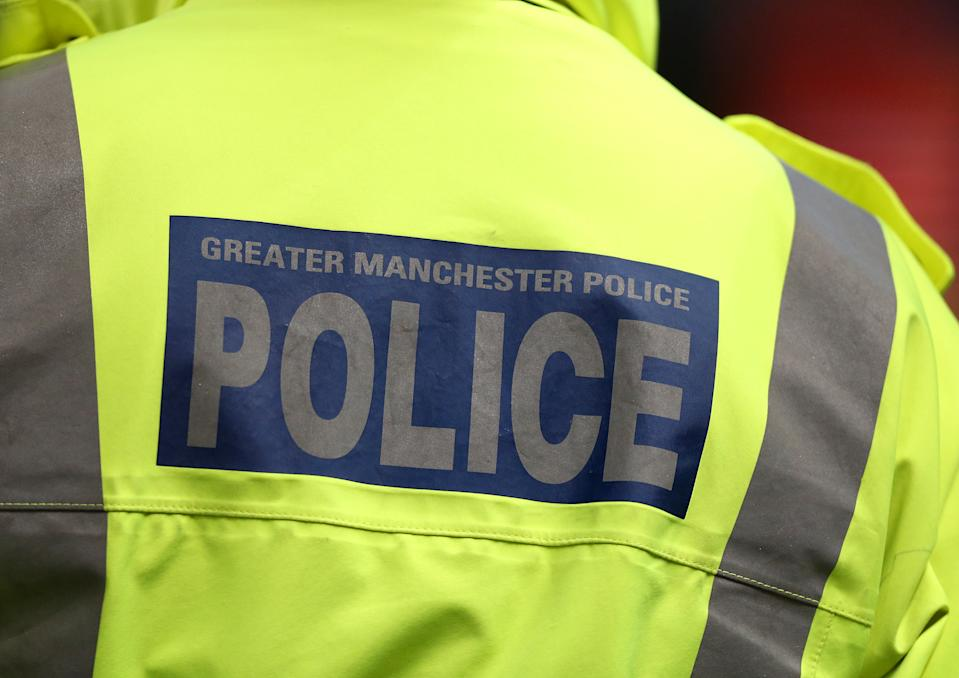 Greater Manchester Police signage on a policeman's jacket   (Photo by Peter Byrne/PA Images via Getty Images)