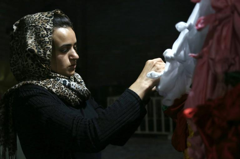 Back in Iraq after the trauma of running into her jihadist former captor in refuge in Germany, 19-year-old Yazidi Ashwaq Haji pays her respects at the holiest shrine of her faith, the Lalish temple north of the jihadists' former bastion Mosul