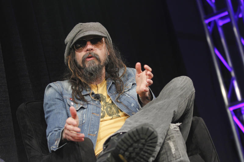 "FILE - This March 12, 2013 file photo shows musician-actor Rob Zombie talking about his new film ""Lords of Salem"" at the SXSW Film Festival in Austin, Texas. Zombie released his fifth studio album, ""Venomous Rat Regeneration Vendor,""  last month, and he plans to support the record with a summer tour of the states, and an appearance at the Rock in Rio Festival in Brazil. (Photo by Jack Plunkett/Invision/AP, file)"