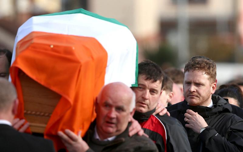 Emmet McGuinness, a son of Northern Ireland's former deputy first minister and ex-IRA commander Martin McGuinness, follows his father's coffin to his home in Londonderry after he died aged 66 - Credit: Niall Carson /PA