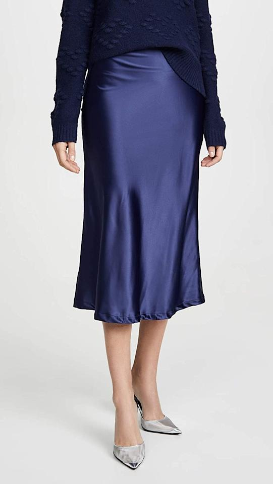 "<p>The mid-night blue shade of this <product href=""https://www.amazon.com/Lioness-Womens-Bias-Skirt-Medium/dp/B07T73K6MJ/ref=sr_1_13?dchild=1&amp;keywords=shopbop+skirts+for+women&amp;qid=1601334740&amp;sr=8-13"" target=""_blank"" class=""ga-track"" data-ga-category=""internal click"" data-ga-label=""https://www.amazon.com/Lioness-Womens-Bias-Skirt-Medium/dp/B07T73K6MJ/ref=sr_1_13?dchild=1&amp;keywords=shopbop+skirts+for+women&amp;qid=1601334740&amp;sr=8-13"" data-ga-action=""body text link"">Lioness Bias Midi Skirt</product> ($72) is so pretty.</p>"