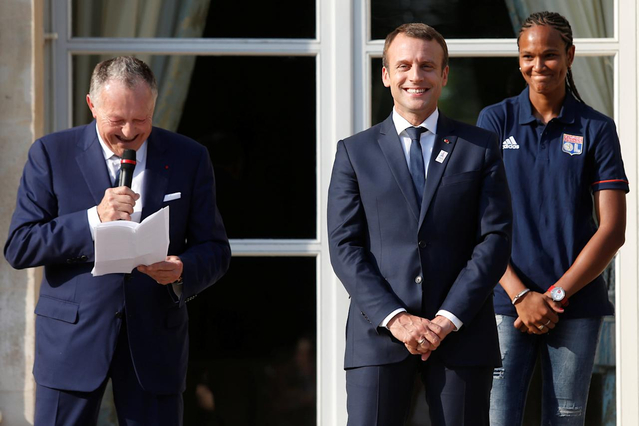 Olympique Lyon's soccer club head Jean-Michel Aulas (L) delivers a speech next to French President Emmanuel Macron (C) as Lyon's French captain Wendie Renard (R) looks on during a ceremony at the Elysee Palace in Paris, France, June 20, 2017 to celebrate the victory of Lyon's football team during the UEFA Women's Champions League.  Picture taken June 20, 2017.    REUTERS/Geoffroy van der Hasselt/Pool