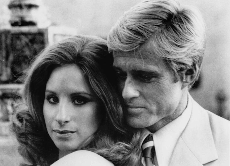 """FILE - This 1973 file photo originally released by Columbia Pictures shows Barbra Streisand, left, and Robert Redford in a scene from the film """"The Way We Were"""".  Marvin Hamlisch a conductor and award-winning composer best known for the torch song """"The Way We Were,"""" died Monday, Aug. 6, 2012 in Los Angeles. He was 68. (AP Photo/Columbia Pictures, file)"""