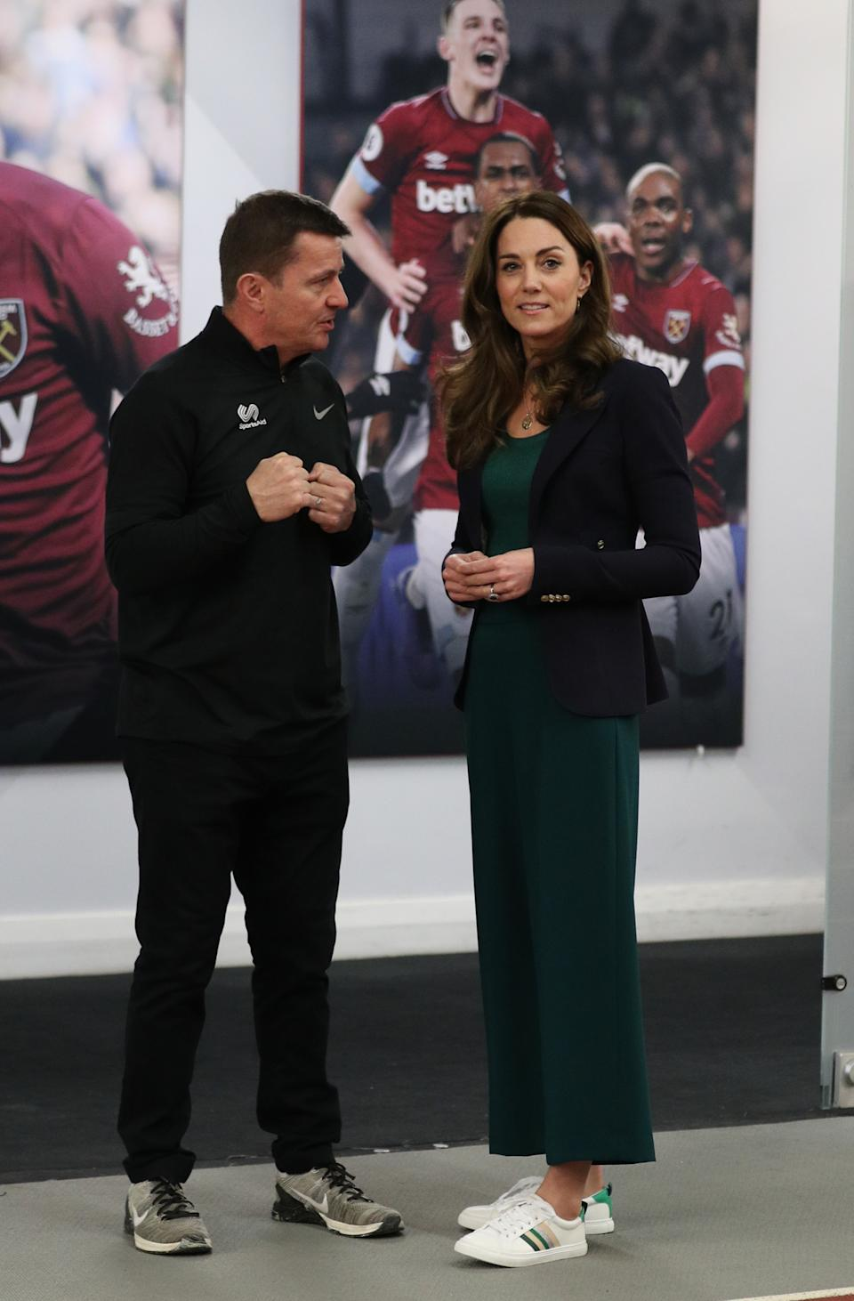 The Duchess of Cambridge wore a pair of M&S trainers, which have since been given a revamp, during a SportsAid event at the London Stadium in Stratford, London, in February 2020. (Getty Images)