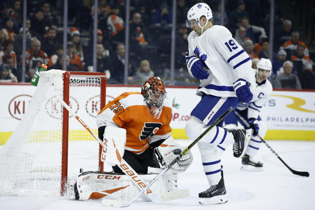 Philadelphia Flyers' Carter Hart (79) blocks a shot as Toronto Maple Leafs' Jason Spezza (19) screens during the first period of an NHL hockey game, Tuesday, Dec. 3, 2019, in Philadelphia. (AP Photo/Matt Slocum)