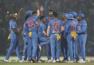 Indian players celebrates the wicket of Bangladesh's Mohammad Naim during their third Twenty20 international cricket match against India in Nagpur, India, Sunday, Nov. 10, 2019.(AP Photo/Rafiq Maqbool)