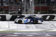 NASCAR Cup Series driver Kyle Larson crosses the finish line to win the NASCAR Cup Series auto race at Charlotte Motor Speedway in Concord, N.C., late Sunday, May 30, 2021. (AP Photo/Nell Redmond)