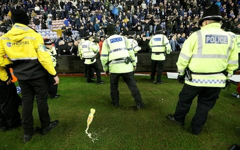 Missiles - FA poised for investigation after Sergio Aguero clashes with invading fan after Manchester City's Cup exit at Wigan - Credit: Action Images