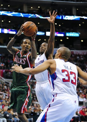 Milwaukee Bucks guard Brandon Jennings, left, looks for an opening against Los Angeles Clippers guard Eric Bledsoe, center, and forward Grant Hill (33) in the first half of an NBA basketball game, Wednesday, March 6, 2013, in Los Angeles.(AP Photo/Gus Ruelas)