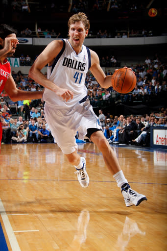 DALLAS, TX - APRIL 18: Dirk Nowitzki #41 of the Dallas Mavericks drives against the Houston Rockets on April 18, 2012 at the American Airlines Center in Dallas, Texas. (Photo by Glenn James/NBAE via Getty Images)