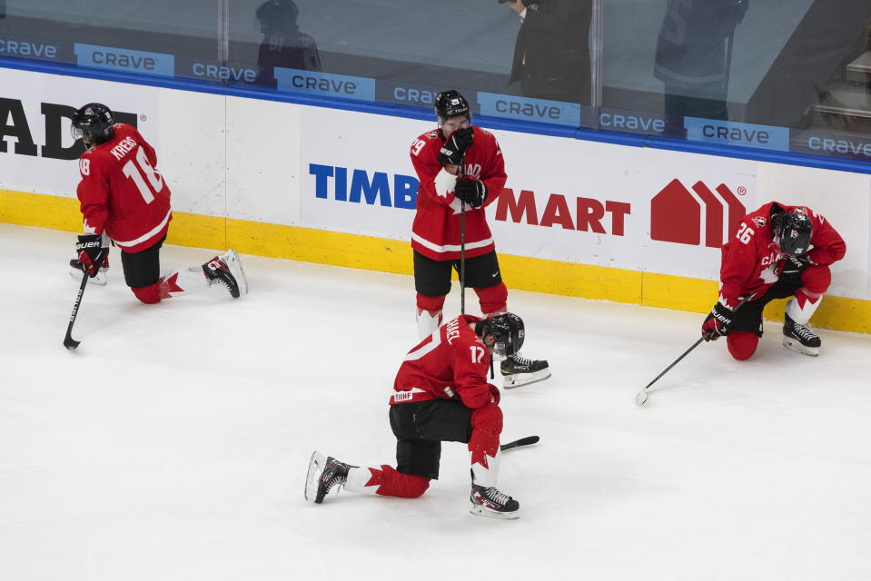 Canada players react to the team's loss to the United States in the championship game in the IIHF World Junior Hockey Championship, Tuesday, Jan. 5, 2021, in Edmonton, Alberta. (Jason Franson/The Canadian Press via AP)