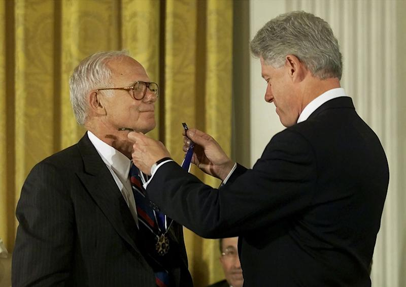 In an Aug. 9, 2000 photo provided by Johnson & Johnson, President Bill Clinton, right, awards former Johnson & Johnson CEO James E. Burke the Presidential Medal of Freedom, in Washington. Burke, who helped the company expand dramatically around the world and steered it through the Tylenol poisonings in the 1980s, died on Friday, Sept. 28. He was 87. (AP Photo/PR Newsfoto, Camera1 NYC)