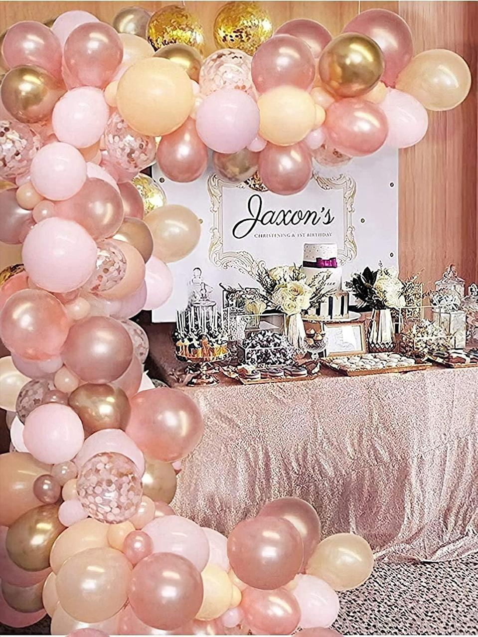 <p>There's nothing more glamorous than this <span>121-Piece Rose Gold and Blush Pink Balloon Garland Arch Kit</span> ($17).</p>
