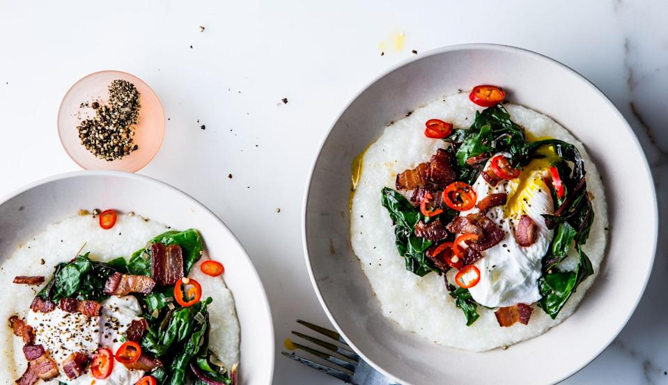 """<a href=""""https://www.bonappetit.com/recipe/cheesy-grits-with-poached-eggs-greens-and-bacon?mbid=synd_yahoo_rss"""" rel=""""nofollow noopener"""" target=""""_blank"""" data-ylk=""""slk:See recipe."""" class=""""link rapid-noclick-resp"""">See recipe.</a>"""