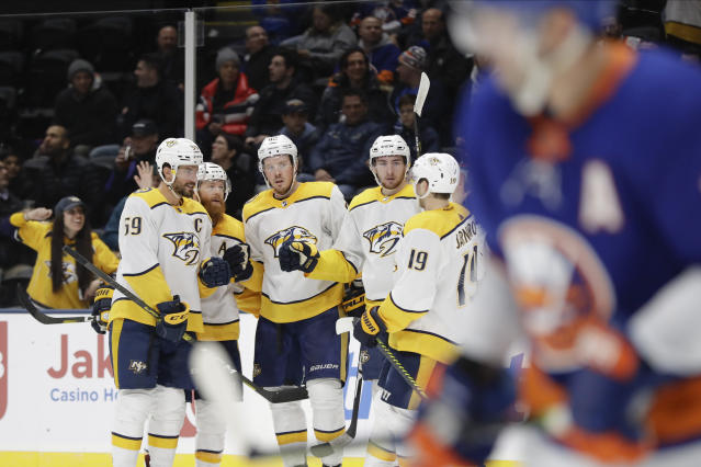 Nashville Predators' Ryan Johansen, center, celebrates with teammates Roman Josi, left, Ryan Ellis, second from left, Calle Jarnkrok, right, and Yakov Trenin after scoring a goal during the third period of an NHL hockey game against the New York Islanders Tuesday, Dec. 17, 2019, in Uniondale, N.Y. The Predators won 8-3. (AP Photo/Frank Franklin II)