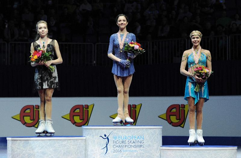 Russia's first placed Evgenia Medvedeva (C) on the podium with second placed Elena Radionova (L) and third placed Anna Pogorilaya, during the European Figure Skating Championships in Bratislava on January 29, 2016