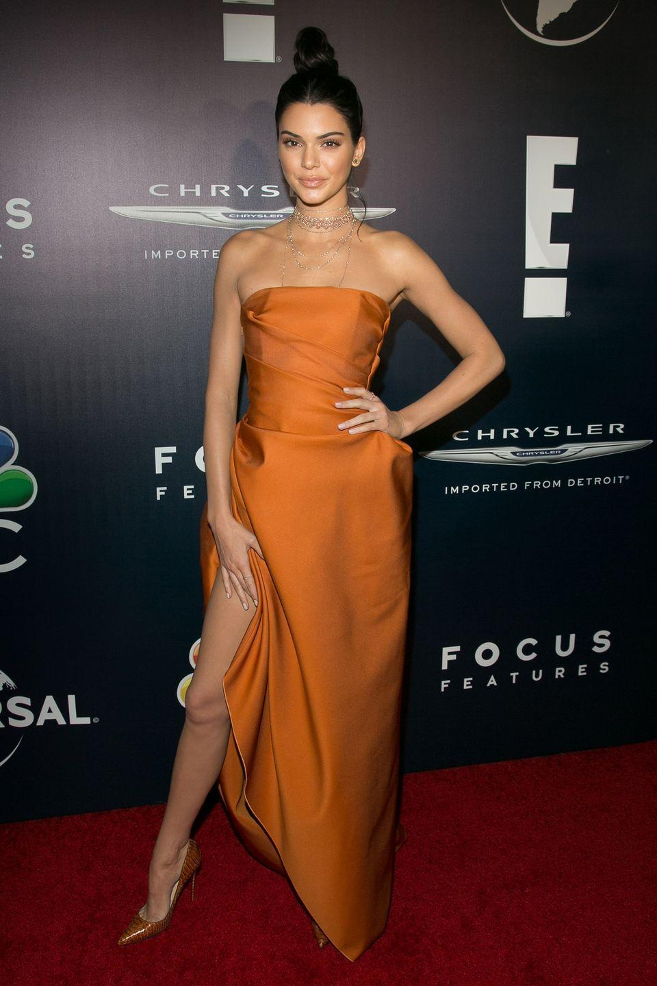 <p>At NBC Universal's Golden Globes after party, Kendall wore this magical burnt orange Paule Ka gown</p>