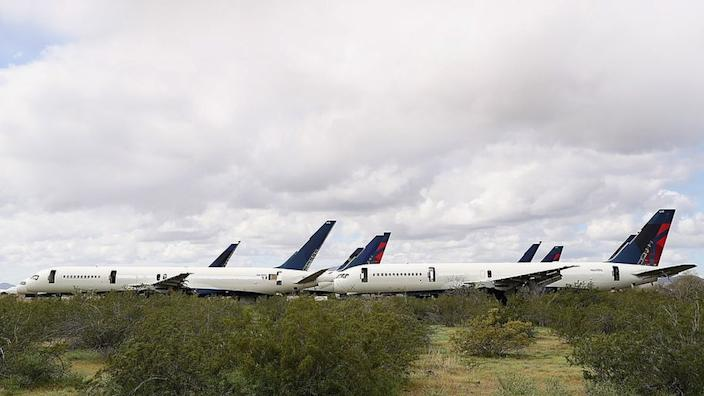 Commercial aeroplanes parked in a storage facility in Arizona in July