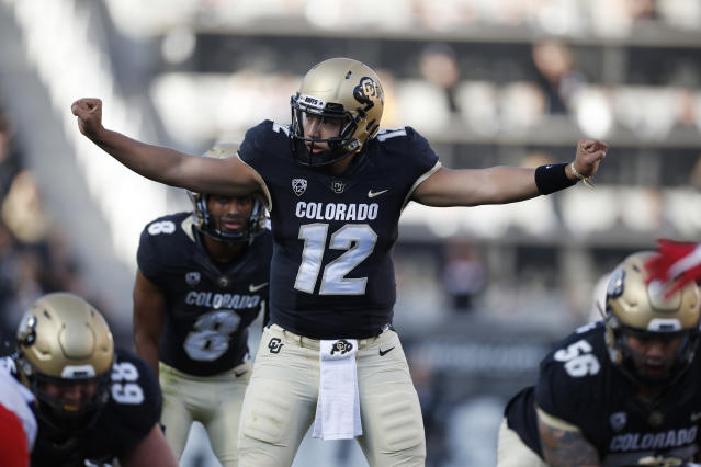 Colorado quarterback Steven Montez directs a play as he prepares to take the snap in the second half of an NCAA college football game against Arizona Saturday, Oct. 5, 2019, in Boulder, Colo. Arizona won 35-30. (AP Photo/David Zalubowski)