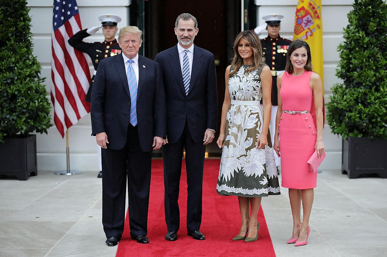 <p>Standing alongside her husband, King Felipe VI and Queen Letizia of Spain for the Spanish royal visit, Melania wore a stunning Valentino olive green dress with intricate white floral embroidery, accessoritisng with a white crocodile belt and Manolo Blahniks.<br />Photo: Getty </p>