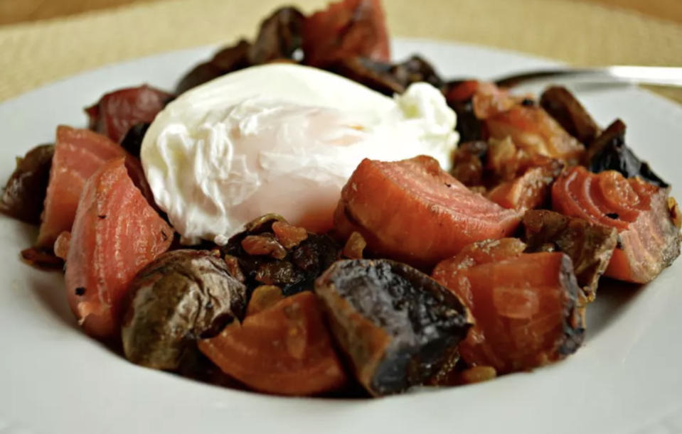 """<p>Red flannel hash is a <a href=""""https://www.thedailymeal.com/travel/what-people-eat-breakfast-around-world?referrer=yahoo&category=beauty_food&include_utm=1&utm_medium=referral&utm_source=yahoo&utm_campaign=feed"""" rel=""""nofollow noopener"""" target=""""_blank"""" data-ylk=""""slk:traditional New England breakfast"""" class=""""link rapid-noclick-resp"""">traditional New England breakfast</a> dish made using leftovers from a boiled dinner the night before. It's made with beets, potatoes and usually corned beef, and comes together as a speedy one-dish breakfast that just needs a fried or poached egg on top. </p> <p><a href=""""https://www.thedailymeal.com/best-recipes/red-flannel-hash-poached-egg-diner-brunch?referrer=yahoo&category=beauty_food&include_utm=1&utm_medium=referral&utm_source=yahoo&utm_campaign=feed"""" rel=""""nofollow noopener"""" target=""""_blank"""" data-ylk=""""slk:For the Red Flannel Hash with Poached Egg recipe, click here"""" class=""""link rapid-noclick-resp"""">For the Red Flannel Hash with Poached Egg recipe, click here</a>.</p>"""