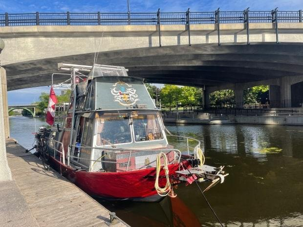 A boat docked by the Rideau Canal. OPP and Parks Canada are warning people to stay safe on the waters, noting a high number of new boat permits issued during the pandemic. (Uday Rana - image credit)