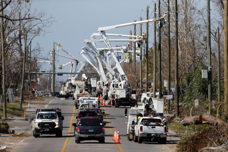 In this Thursday, Oct. 18, 2018 photo, utility crews set up new poles and utility wires in the aftermath of Hurricane Michael in Panama City, Fla. It's the greatest need after a hurricane and sometimes the hardest one to fulfill: Electricity. More than a week after Hurricane Michael smashed into the Florida Panhandle on a path of destruction that led all the way to the Georgia border, more than 100,000 Florida customers were still without power, according to the state Department of Emergency Management website. (AP Photo/Gerald Herbert)