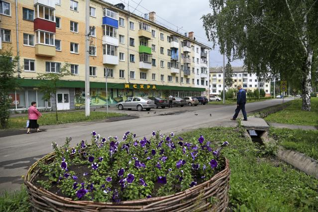 In this photo taken on Thursday, July 5, 2018, an apartment building where Russian star midfielder Alexander Golovin grew up, in Kaltan, Russia. When Russia plays at the World Cup, Kaltan looks like a ghost town. This remote Siberian coal-mining town is the home of Golovin, whose key role in Russia's run to the World Cup quarterfinals has made him a national hero. (AP Photo/Yaroslav Belyaev)