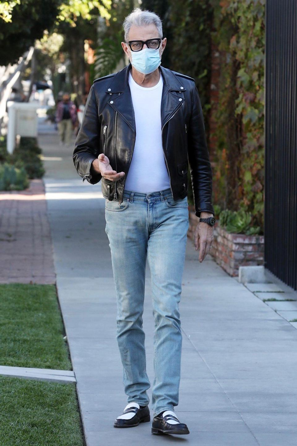 <p>Jeff Goldblum arrives at Melrose Place in L.A. on Tuesday, wearing a leather jacket and jeans.</p>