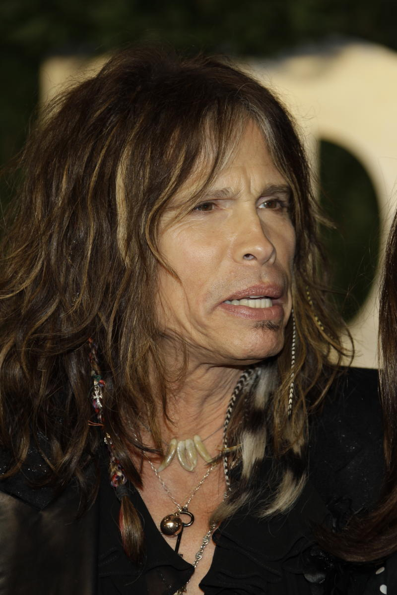 Steven Tyler arrives at the Vanity Fair Oscar Party at the Sunset Tower in Los Angeles, Calif., Sunday, Feb. 27, 2011. (AP Photo/Carlo Allegri)