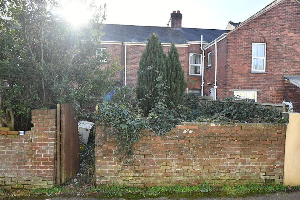 The overgrown garden at an address in Exeter, where the body of a man was found. (PA Images)