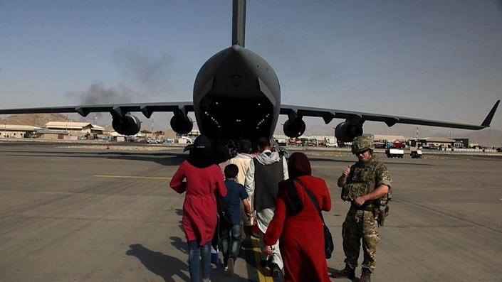 A family boarding a plan to leave Afghanistan